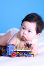 Baby with toy Stock Images
