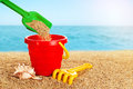 Baby toy bucket, shovel and rake in the sand. Royalty Free Stock Photo