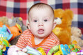 Baby among toys months Royalty Free Stock Photos