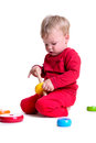Baby with toys portrait of cute little caucasian sitting isolated on white background year Stock Photos