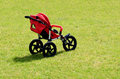 Baby transport a modern pram isolated against a green grass background during summer season concept photo of babies children Royalty Free Stock Photography
