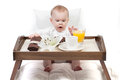 Baby and a tray with breakfast Stock Images