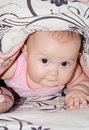 Baby under the blanket beautiful girl hiding a Royalty Free Stock Photos