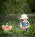Baby with vegetables and fruits Royalty Free Stock Photography