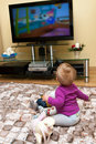 Baby watching television Royalty Free Stock Photo
