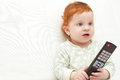 Baby watching tv toddler holding remote control Stock Photography