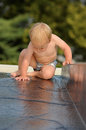 Baby on water slide Royalty Free Stock Photo