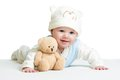 Baby weared funny hat with plush toy Royalty Free Stock Photo