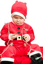 Baby wearing Santa suit Stock Photos