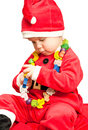 Baby wearing Santa suit Stock Images