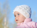 Baby in a white cap portrait against the sky Stock Photo