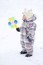 Baby with whizzer in winter year outdoors Stock Images