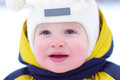 Baby in winter portrait of year with rosy cheeks outdoors Stock Photography