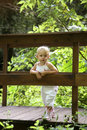 Baby on a wood bridge Royalty Free Stock Photo