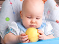 Baby with yellow apple newborn Stock Images