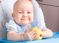 Baby with yellow apple newborn Royalty Free Stock Image