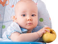 Baby with yellow apple newborn Royalty Free Stock Photo