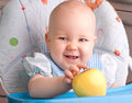 Baby with yellow apple newborn Stock Photography
