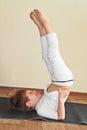 Baby yoga at home Royalty Free Stock Photo