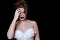 Babyface female model wearing strapless white dress on black background Royalty Free Stock Photo