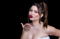 Babyface female model wearing strapless white dress on black background Royalty Free Stock Photo