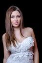 Babyface female model wearing strapless white dress Royalty Free Stock Photo