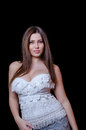 Babyface female model wearing strapless white dress Royalty Free Stock Photo