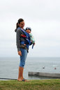 Babywearing young mother wearing happy baby boy Stock Images