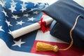 Bachelor hat and diploma on american flag Royalty Free Stock Photo