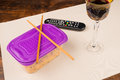 Bachelor meal leftovers out of the food box and television a dinner Royalty Free Stock Photos