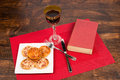 Bachelor menu fast food a glass of wine and a book a lonely dinner Stock Photography