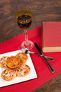 Bachelor saturday evening fast food glass of wine and a book a concept Royalty Free Stock Images