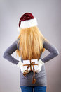 Back of awoman with christmas gift Royalty Free Stock Image