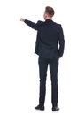 Back of business man pointing with hand in pocket Royalty Free Stock Photo