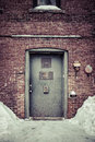 Back door alley way a grungy metal security on an old brick city building in a Royalty Free Stock Photography