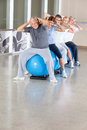 Back exercises on gym ball in gym Royalty Free Stock Image