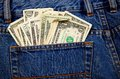 Back jeans pocket full of cash a a pair blue currency in us dollars Royalty Free Stock Photos