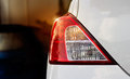 Back lights of white car after the rain on car parking Royalty Free Stock Photo