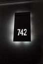Back lit hotel room number. Royalty Free Stock Photo