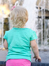Back of little girl looking to fountain Stock Photos