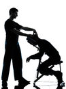 Back massage therapy with chair two men performing in silhouette studio on white background Royalty Free Stock Image