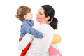 Back of mother and son with balloons looking to toddler boy holding isolated on white background Royalty Free Stock Image