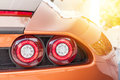 Back of an orange sport luxury car in sunset Royalty Free Stock Photo