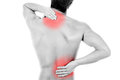 Back pain young man with isolated in white Royalty Free Stock Photography