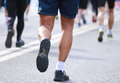 Back of people legs running calves Royalty Free Stock Photo