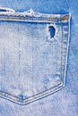 Back pocket of blue, ripped jeans Royalty Free Stock Photo