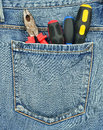 Back pocket of jeans with tools Stock Images