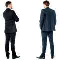 Back pose of handsome young corporates two businessmen facing towards the wall Stock Photography