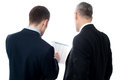 Back pose of handsome young executives businessmen analyzing the financial reports Royalty Free Stock Images