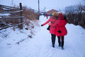 Back profile of two girls in snow Royalty Free Stock Photo